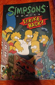 Книга Simpsons comics strike back